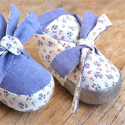 Sew up a pair of adorable Reversible Baby Booties for the perfect baby shower gift.