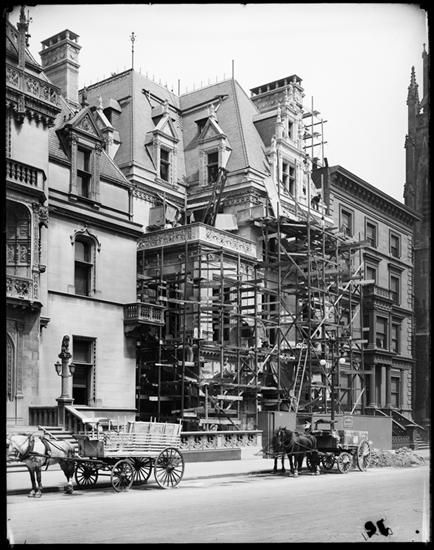 "Virginia Fair Vanderbilt House   New York, NY. Construction (1905-1907) underway on the residence of Mr. & Mrs. W. K. Vanderbilt, Jr. at 666 Fifth Ave. On the left, Mr. W. K. Vanderbilt's ""Petit Chateau."""