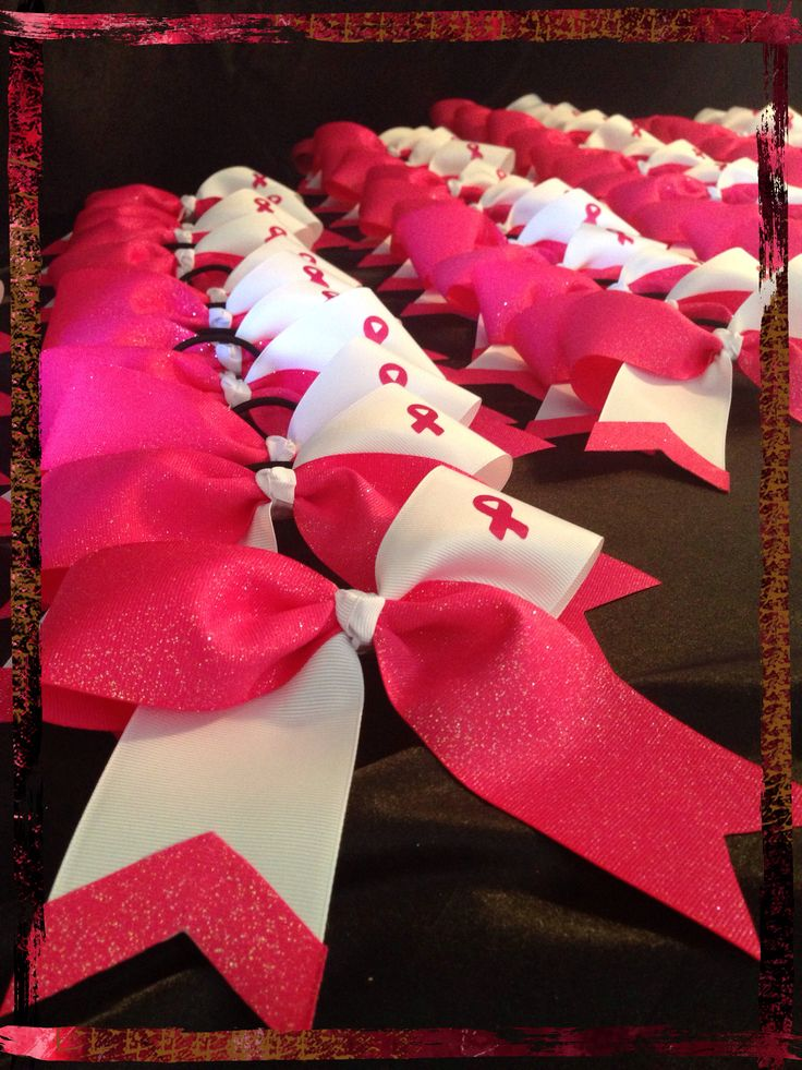 Breast cancer awareness cheer bows by Pamper Me Cakes