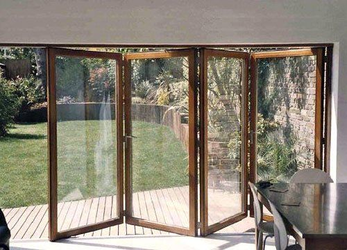 Wooden Bi Folding Patio Doors...this would be awesome in my lliving room right to the deck