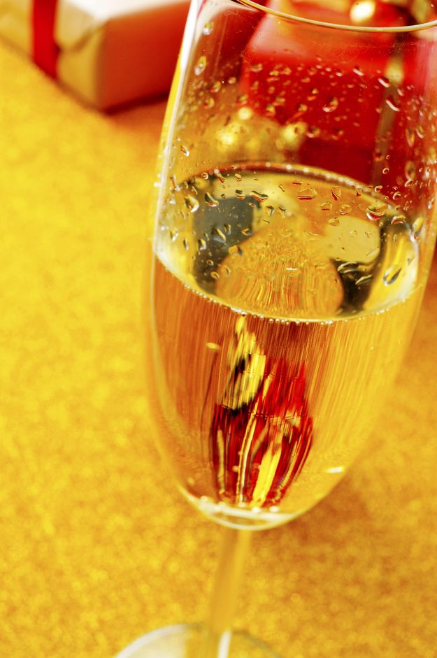 Write down a wish on a piece of paper, burn it, throw it into a champagne glass, and drink it before 12:01. | The Weirdest New Year's Eve Traditions From Around The World