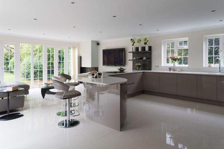 High gloss handless kitchen. Featuring a curved breakfast bar.