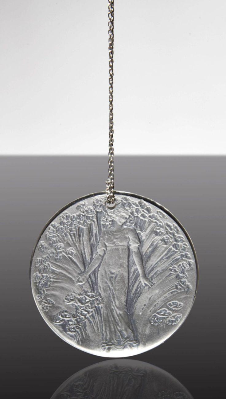 """René LALIQUE - An Art Deco moulded glass pendant """"Figurine dans des fleurs"""", model created in 1919. Signed """"R.Lalique""""."""