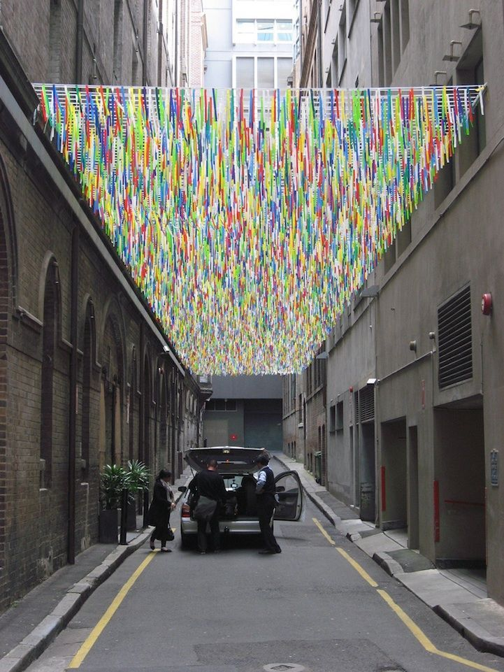 'I will create a ceiling, a sea of bunting in the lane. Moving in the breeze & catching the mood of those that walk beneath it, a swathe of trailing tentacles responding to  the flow of air & people through the lane, making the invisible visible & reminding people to breathe' : Nike Savvas