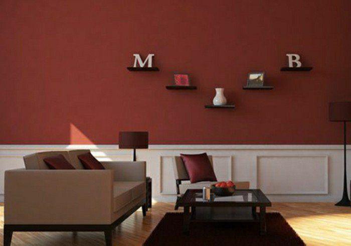 peinture murale salon en rouge fonce couleur de peinture pour salon canape beige coussins rouges