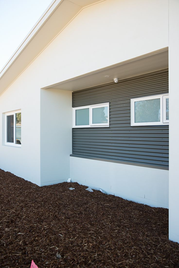 New house at Wright mixing aluminium cladding and uPVC windows