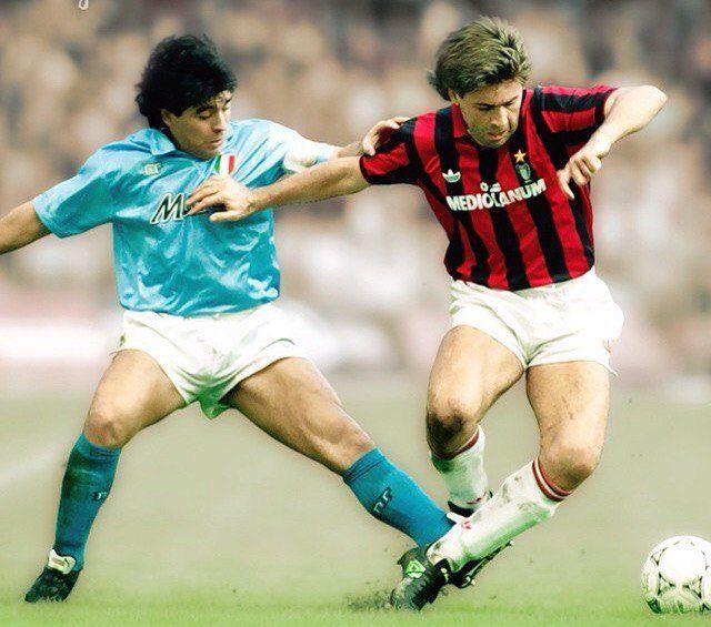 Carlo Ancelotti of inter Milan gets the better of Napoli's Diego Maradona