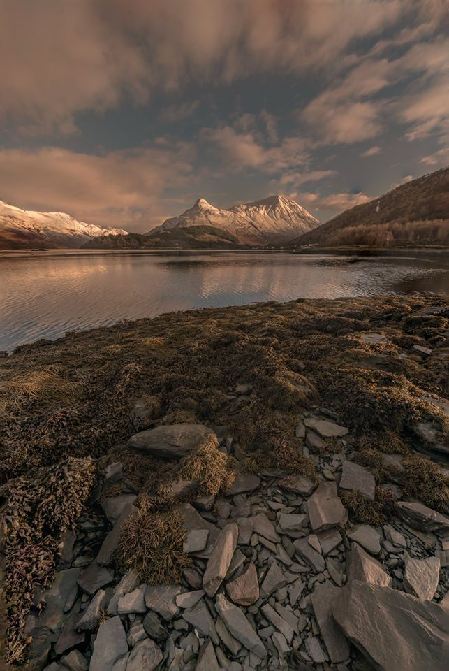 The Pap of Glencoe reflects upon Loch Leven in the Highlands of Scotland