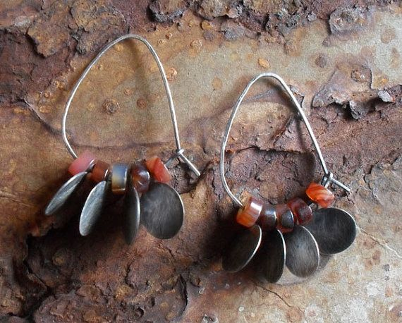 Lisa Flanders - Sterling Silver Hoop Earrings: Carnelian Jeweled Hoops. Oval hand-forged sterling silver hoop earrings embellished with rich rust brown carnelian beads and darkly oxidized sterling silver discs