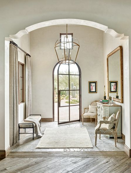 Simply stunning entryway. I love how the oversized lantern chandelier keeps the space feeling light and airy.