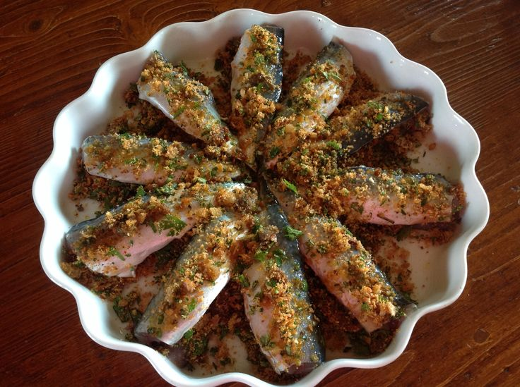 Baked sardines with fresh herbs, capers, sundried tomatoes and bread crumbs... Cucina mediterranea at its best!