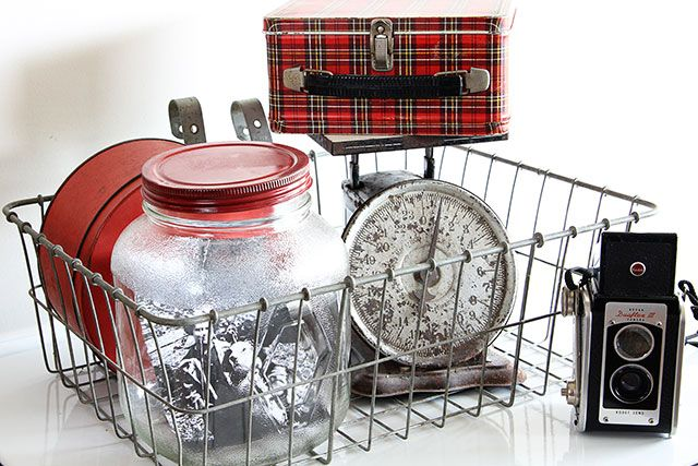 Eclectic vintage vignette with Kodak Duaflex camera, plaid Aladdin lunch box and rusty scale