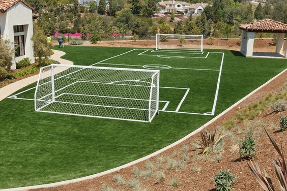 Here is an awesome backyard soccer field that features First Team's Golden Goal 44 Element portable soccer goals