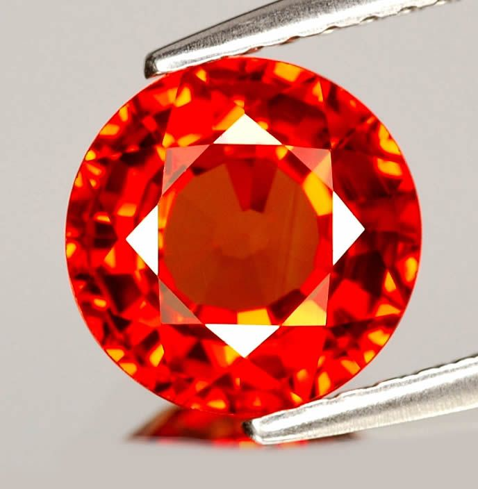 orange sapphires have something so enchanting about them that is normally only visible in person, they look like fire.