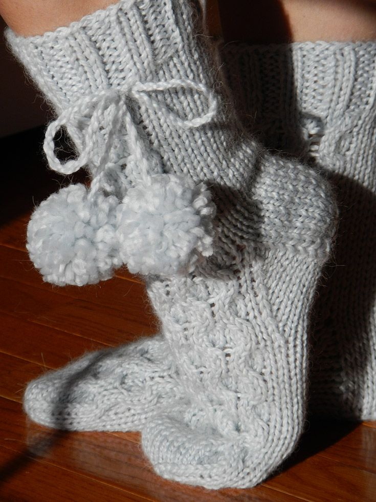 Honeycomb pattern chunky socks with pom poms.