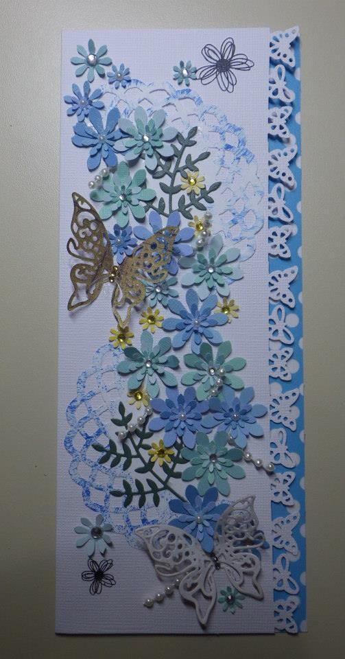 All the flowers are handpunched, the greenery, butterflies and doiley are die cut