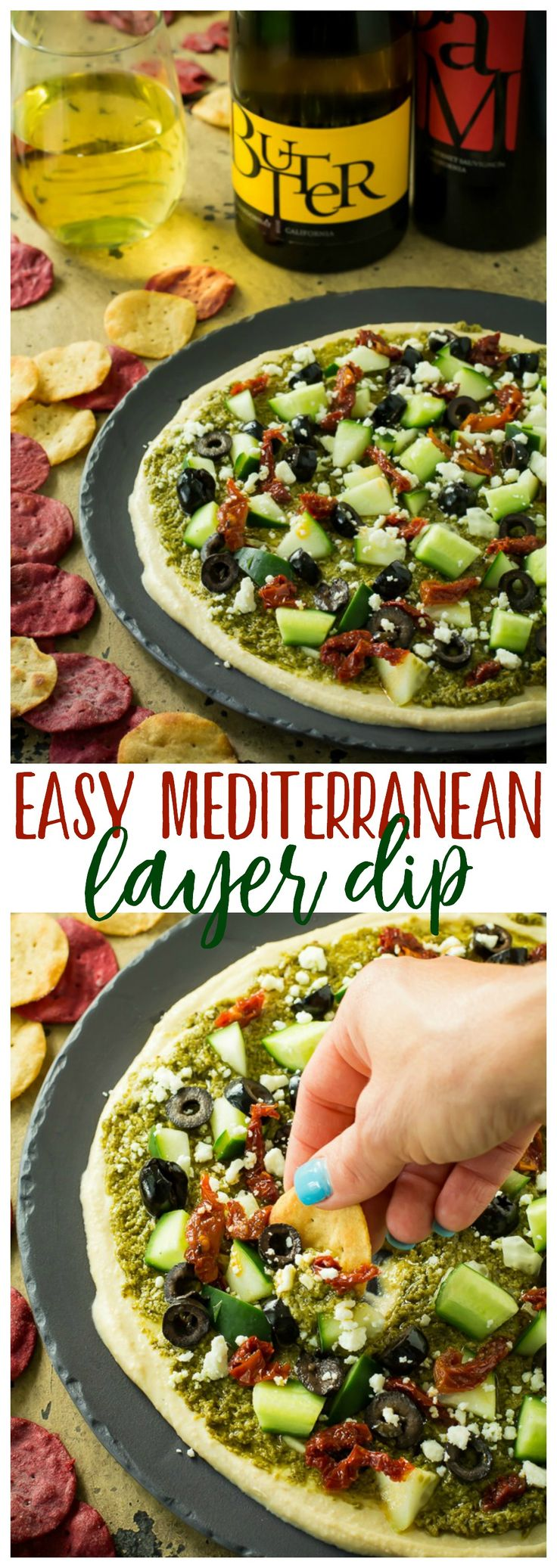 A healthy, tasty, easy Mediterranean layer dip recipe that is a great appetizer or wholesome snack. Loaded with goodies, like hummus, pesto, feta, olives and sun-dried tomatoes. Just don't forget the easy-to-love, witty and fun JaM Cellars! #JaMwinetime 21+ #ad