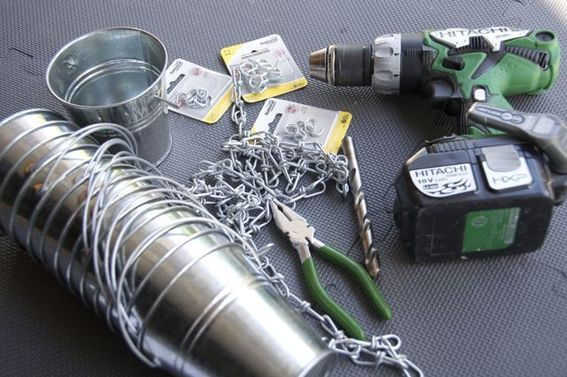 rain chain diy projects- use recycled cans or paint cans~ I am definitely making one of these!