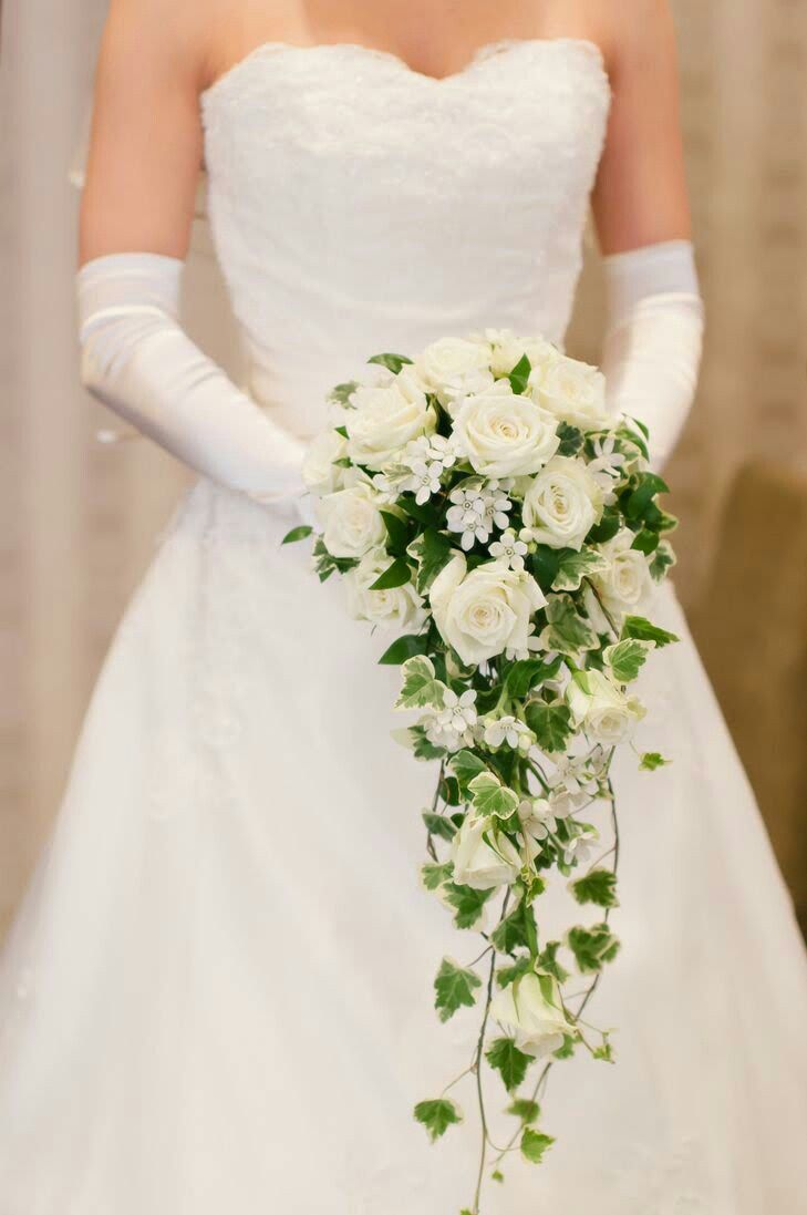 Cascading Bridal Bouquet Showcasing: White Roses, White Spray Roses, White Bouvardia, Green Trailing Ivy