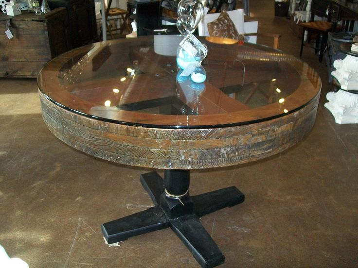 "Perfect for a pub room or lounge, this repurposed mill wheel table measures 47"" in diameter and seats six comfortably."