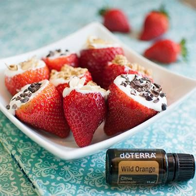 Strawberries filled with Greek Yogurt, Wild Orange Essential Oil and Toppings....YUM!!!