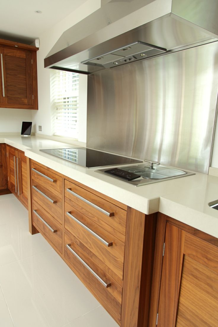 Miele induction sits next to a Wolf steamer, thick Ivory Caesarstone Quartz worktops