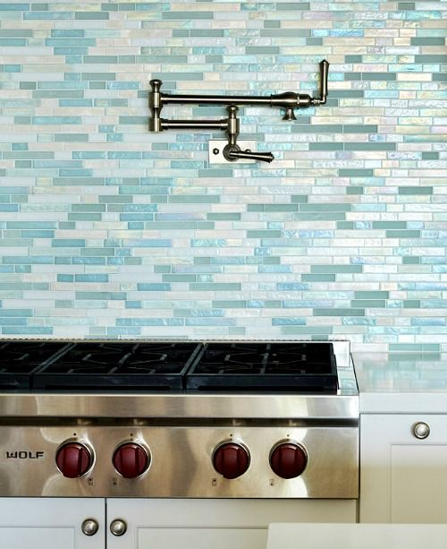 Sea glass tile kitchen backsplash tiles in shades of blue and turquoise,  capturing the sparkling