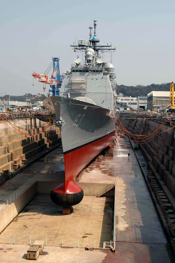 Yokosuka, Japan (Mar. 16, 2004) - The guided missile cruiser USS Cowpens (CG 63) at the completion of its Ships Repair Force (SRF) dry dock period in Yokosuka, Japan. The Ticonderoga class cruiser is forward deployed to Yokosuka. (US Navy photo)