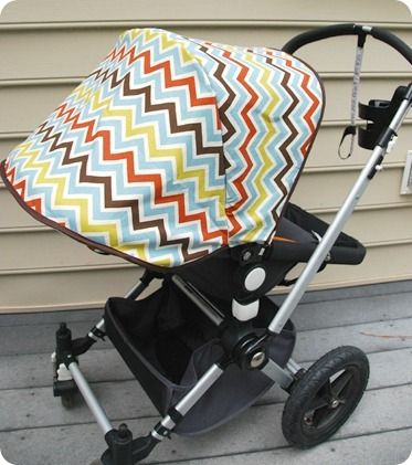 Make your own stroller canopy! I still don't know why stroller and carseat designers use such ugly fabrics on their baby gear...you would think they would get the hint by now?