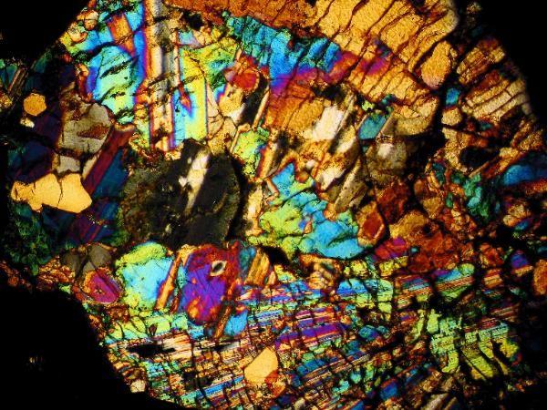 Dhofar 535 meteorite thin section viewed through a polarizing microscope