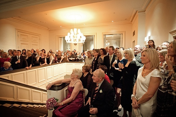 Guests around stairwell watching ceremony