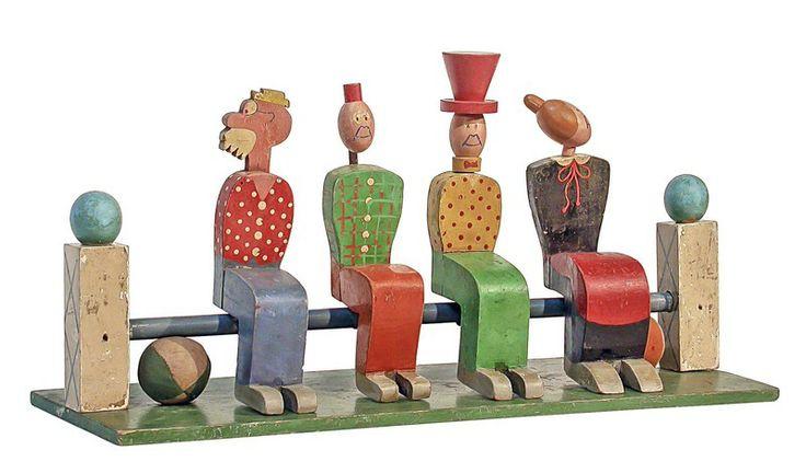 """Birilli - 41,5 x 48 x 48 cm, legno tornito e laccato, attribuiti AVIL, presumibilmente ditta L. Masi, Spresiano (TV), 1922 ca., i personaggi ispirati alle strisce del """"Corriere dei Piccoli"""": Ciccio, Arcibaldo, Signor Bonaventura e Fortunello. Pubblicato nel catalogo della mostra """"The Century of the Child"""", MOMA, New York, 2012."""