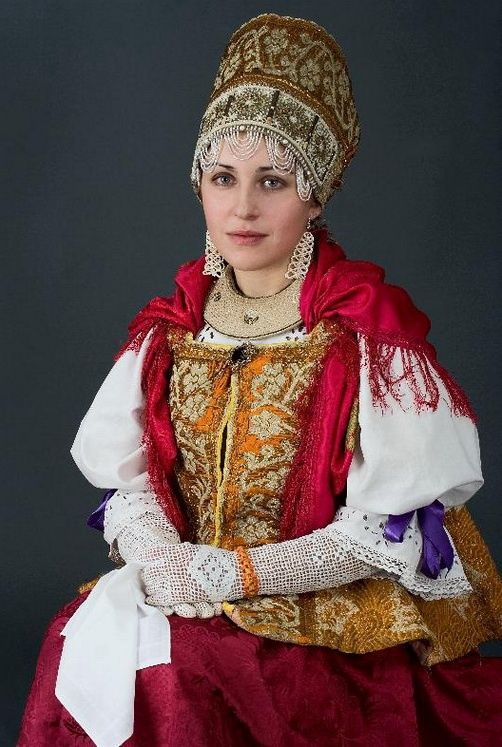 Russian woman in traditional dress. (source)