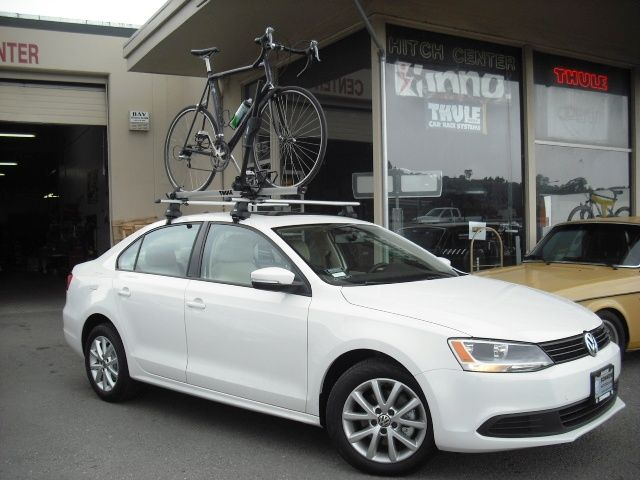 VW Jetta With Thule 480R Foot Package With Aeroblade Set Up And Rooftop  Bike Rack
