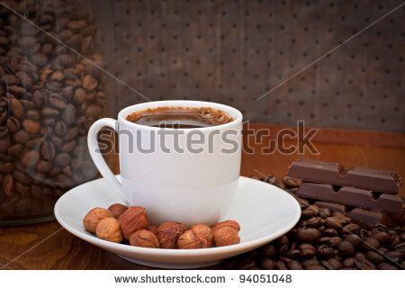 cup of coffee, hazelnut and chocolate - stock photo