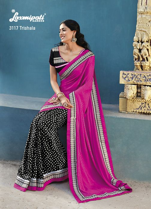 Retro look is given to this pink  black saree by white dots on the black portion  with nice embroidary on the border patti.