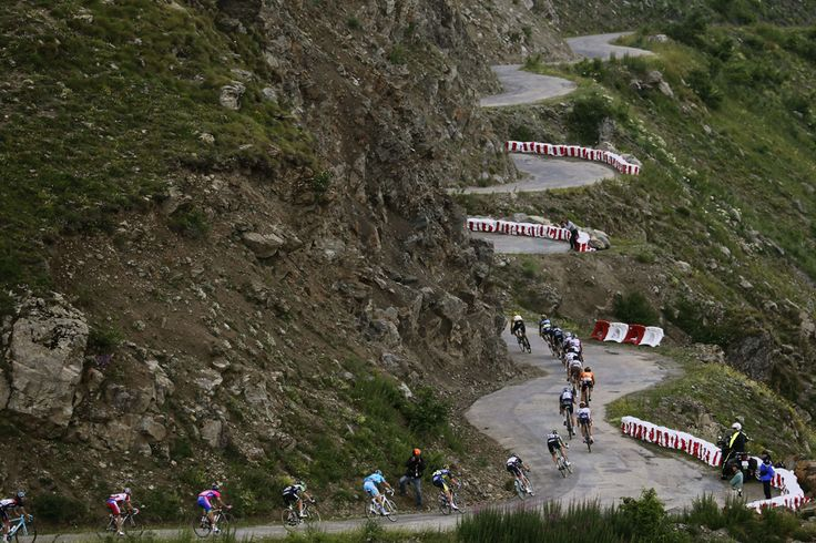 The pack rides in the Col de Sarenne during the 172.5 km eighteenth stage of the 100th edition of the Tour de France cycling race on July 18 between Gap and Alpe-d'Huez, French Alps. (Joel Saget/AFP/Getty Images - See more at: http://www.boston.com/bigpicture/2013/07/tour_de_france_100th_edition_p_1.html#sthash.Lx9uVNEJ.dpuf