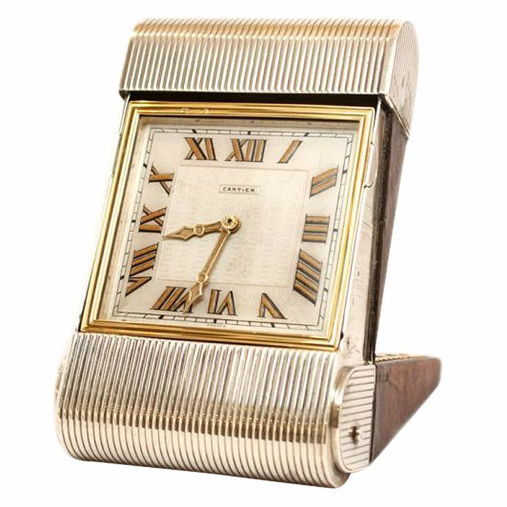 CARTIER Gold, Silver and Leather Travel Clock   From a unique collection of vintage  at http://www.1stdibs.com/jewelry///