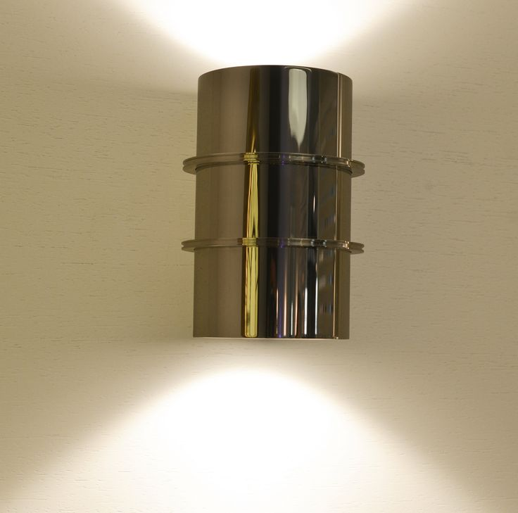 Versus bespoke lights Cylinder shaped LED wall light with two sides light emission, built in AISI 316L STAINLESS STEEL with a high degree of protection. Versus is a pure design element to enlighten walls, corridors, main entrances and façades, providing shafts of light both up and down.