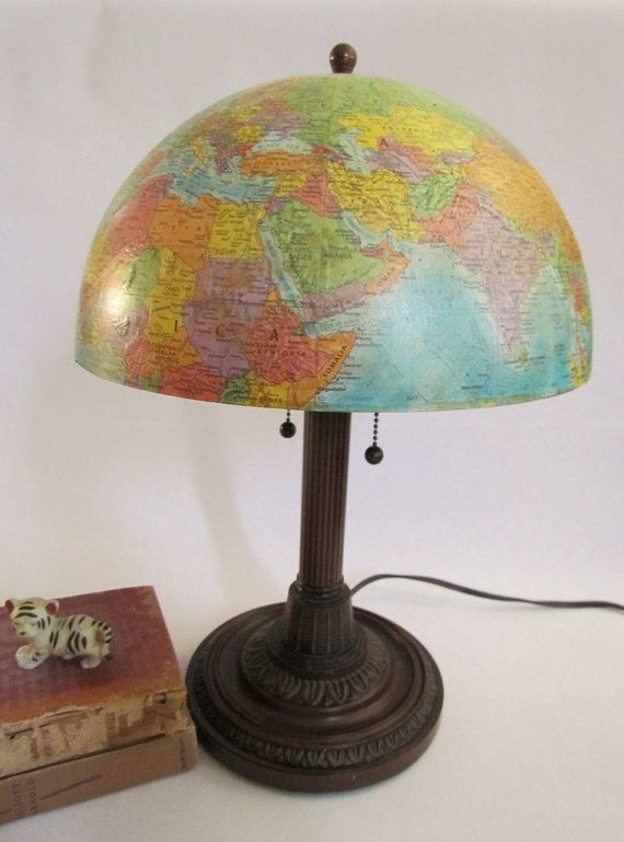 I love this! Etsy vendor Recycling Tomorrow (clcort) gave a discarded lamp base a perfectly proportioned globe shade. This would be perfect for a library, school room or a children's room with a travel/map theme.