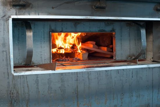 Building a wood fired bread and pizza oven - firing door to improve airflow during firing