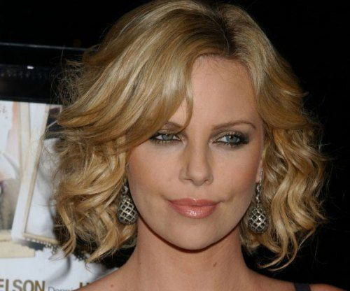 blonde layered curly bob hairstyle
