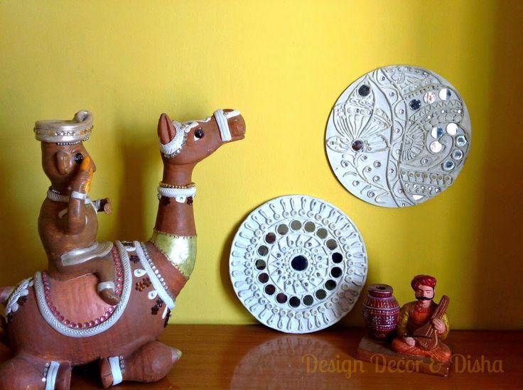 Lippan kaam (Mud Mirror art) from Kutch Gujarat, India - Lippan designs made at home