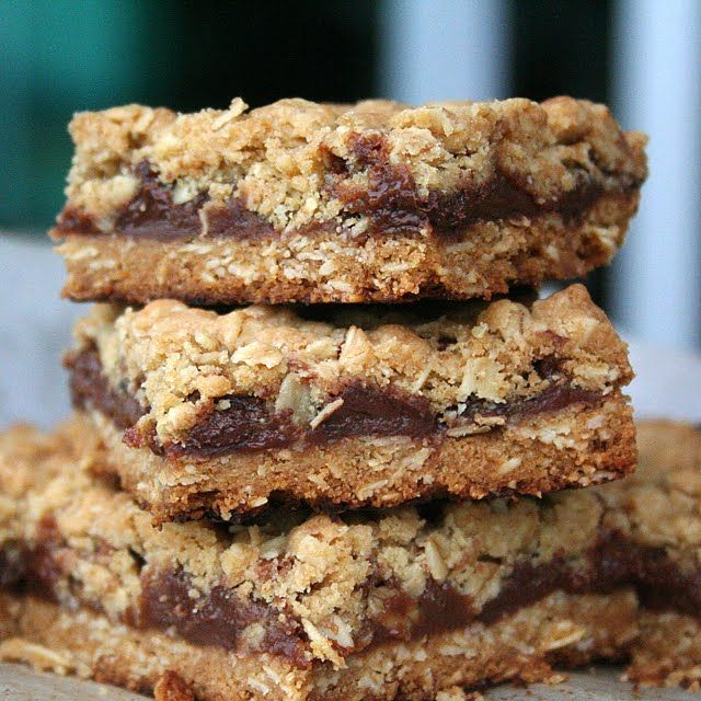 Oatmeal Mars Bars. Can also be made with Milky Ways.  Another similar recipe says not to bother baking the bottom layer, just to layer it up and bake it once.