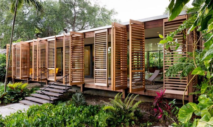 Brillhart Architecture's breezy Brillhart Residence in Miami takes inspiration from Tropical Modernism with wooden shutters.