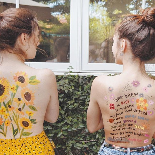 """She blew a kiss, it missed my face, and drifted into outer space and kissed the sun, and made it smile, now it's been bright for quite a while"" A poem from my book Make Magic Do Good painted (not by me) on the back of @delaney_mcneill . It's hot as can be this weekend, apologies for blowing that kiss and stirring up the sun. Best of luck finding some shade and some friends to paint on!"