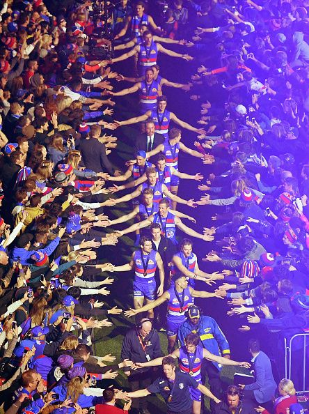 The Bulldogs walk through the crowd after being presented on stage after winning the 2016 AFL Grand Final match between the Sydney Swans and the...