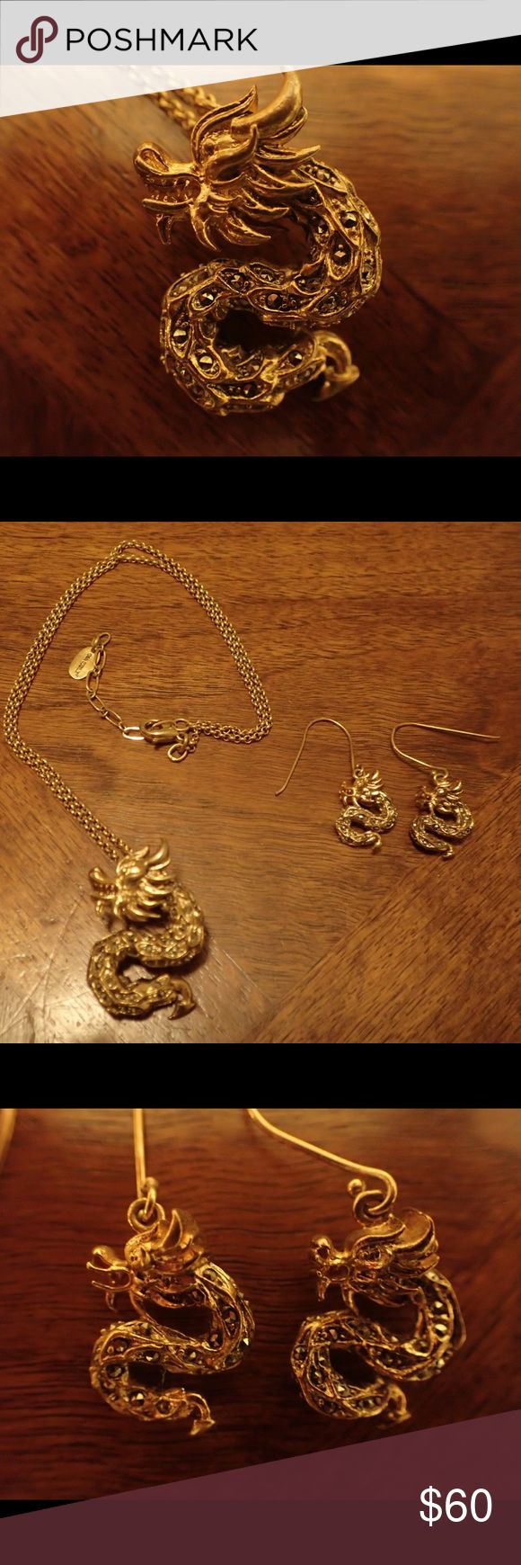 "14-Kt Gold Dragon Necklace and Earring Set 14kt gold-plated dragon necklace and matching earrings. Necklace is on a 18"" gold chain with extension out to 20"".   Necklace pendant dragon is 1 1/2"" in length and earring dragons are 3/4"". Gia Mele Jewelry"