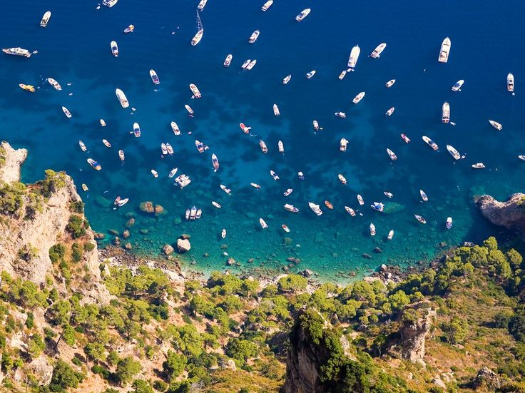 By reputation, Capri is Italy's most glamorous island—it's more dramatic than drop-dead gorgeous, like a Fellini actress who ages gracefully. From the the iconic Faraglioni rocks settled in the azure Mediterranean to the scent of the island's many flowers, it's almost sensory overload.