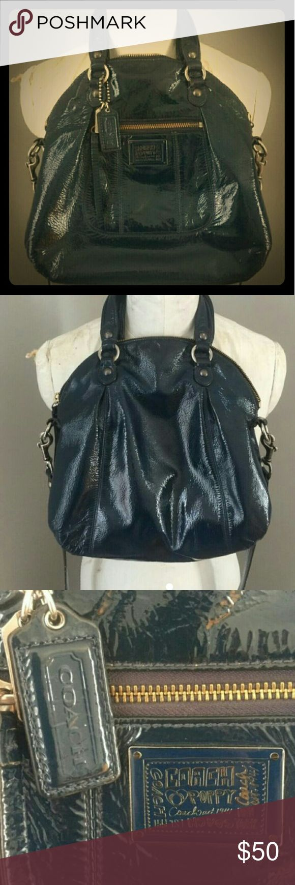 """Coach Poppy patent leather crossbody Authentic Coach Poppy navy bowling bag. 3 interior pockets, one with zip closure. 12"""" W x 11"""" H. Crossbody strap can be removed - 45"""" in length. Three minor defaults: 1. The zipper has been replaced. I don't know if it's the way that I zip but the teeth are ever so slightly detached from the top (about 1cm but still zips shut). 2. The bottom of the bag has a couple pen stains- see picture 3. 3: the pull tabs on the zipper are separating. Price dropped for…"""